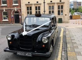 Black London Taxi for wedding hire in Bedford